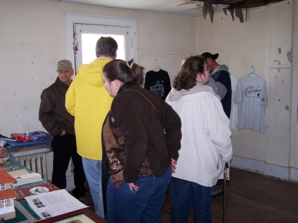Visitors browse the PLLPS scrap book created by Kim Hammond, our Director of Paranormal Investigations